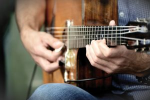 Onmisbare tips en trucs om succesvol online gitaarlessen te volgen!